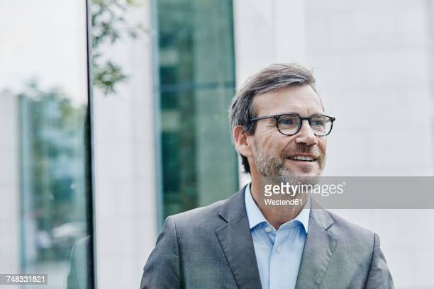Smiling mature businessman outdoors