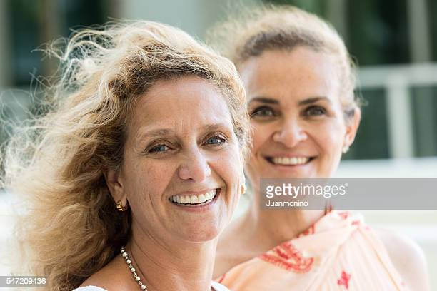 smiling mature caucasian siblings - israeli woman stock pictures, royalty-free photos & images