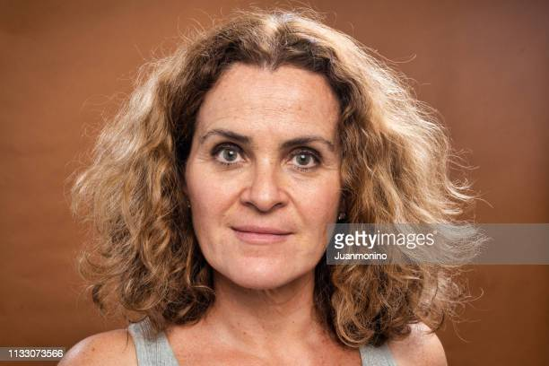 smiling mature caucasian woman looking at the camera - beautiful israeli women stock pictures, royalty-free photos & images