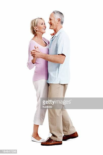 smiling mature couple dancing - gewalt stockfoto's en -beelden