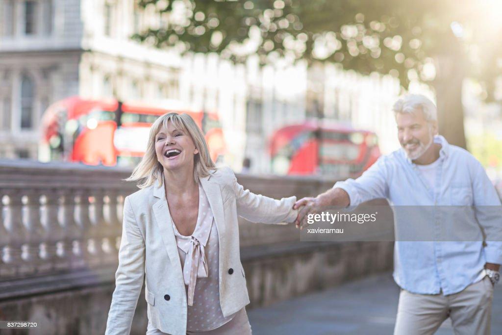 Smiling mature couple having fun in London : Stock Photo