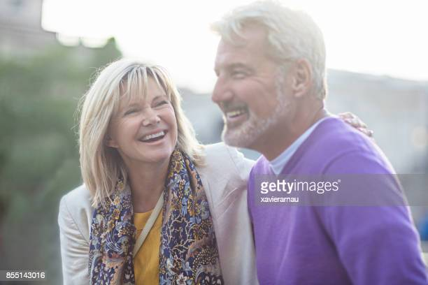 Smiling mature couple standing in the street