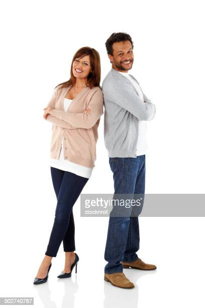 Smiling mature couple standing on white