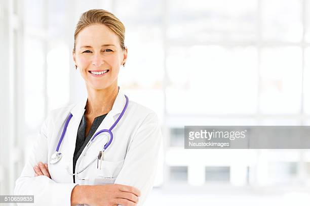 Smiling Mature Doctor In Hospital