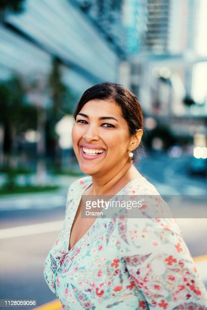 smiling mature latina businesswoman in the financial district in usa - plus size model stock pictures, royalty-free photos & images
