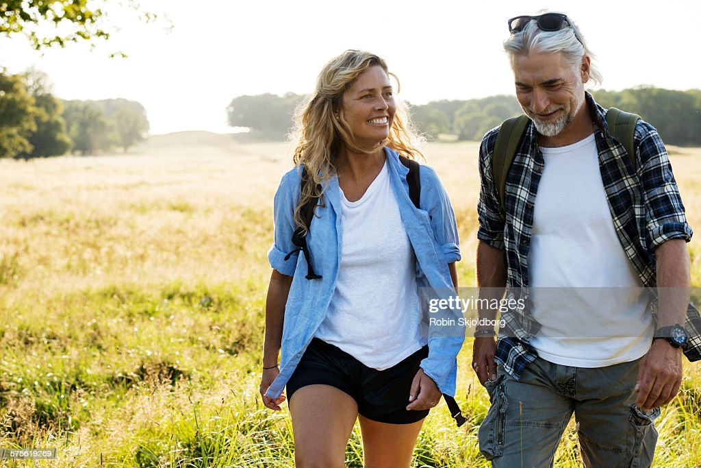 Smiling Mature Man and Woman hiking : Stock Photo