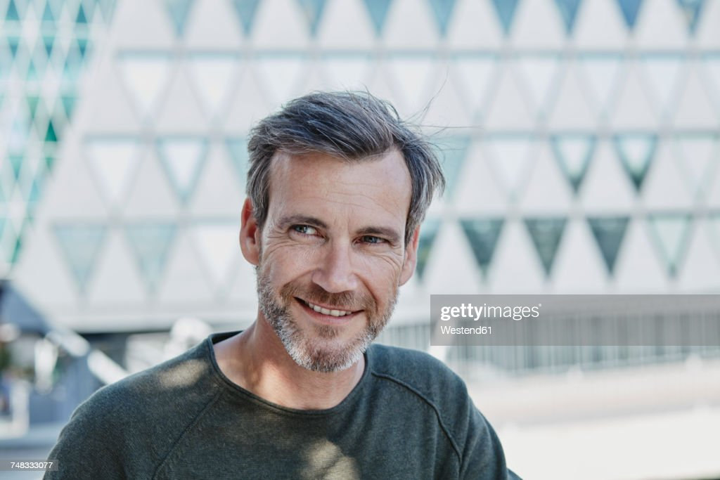 Smiling mature man outdoors : Stock Photo