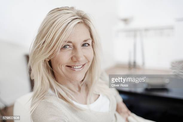 Smiling mature woman at home, portrait