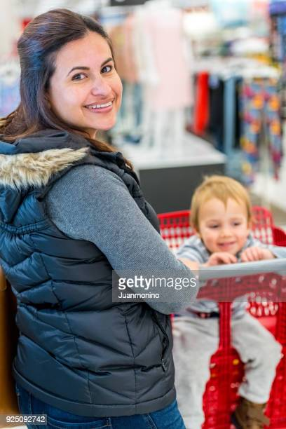Smiling Mature Woman shopping with her son