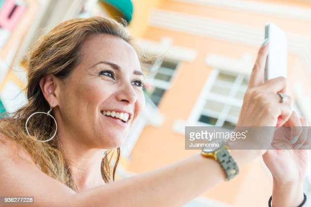 Smiling mature woman taking a selfie