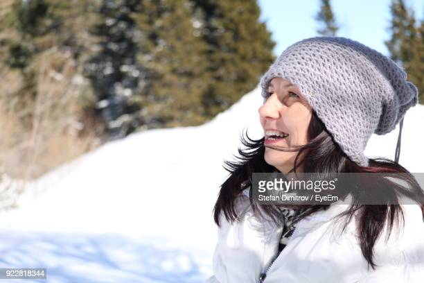 Smiling Mature Woman Wearing Warm Clothing During Winter