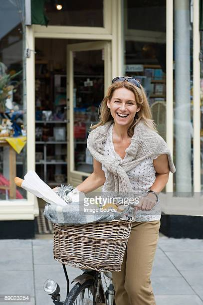 Smiling mature woman with a bicycle