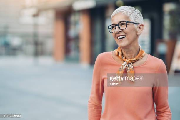 smiling mature woman with short hair and eyeglasses - beautiful people stock pictures, royalty-free photos & images