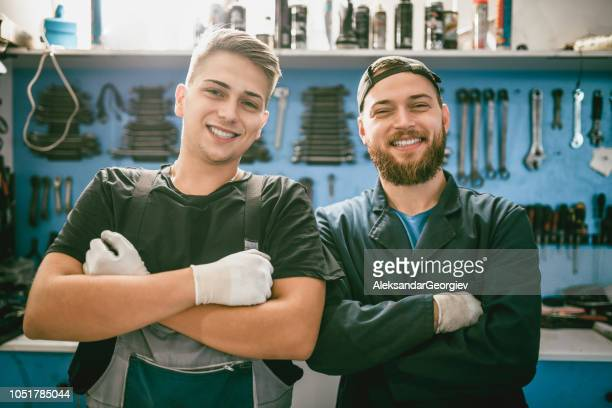 smiling mechanics posing - trainee stock pictures, royalty-free photos & images