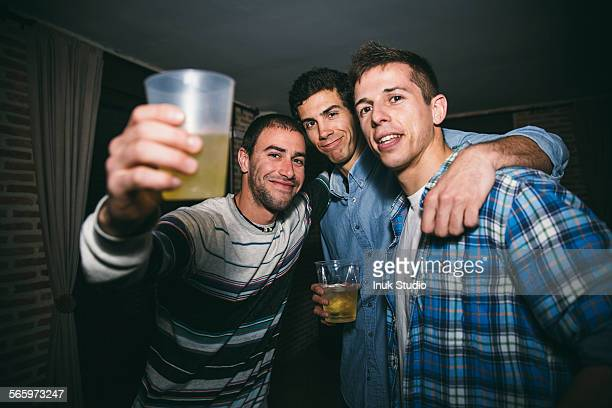 Smiling men drinking in nightclub