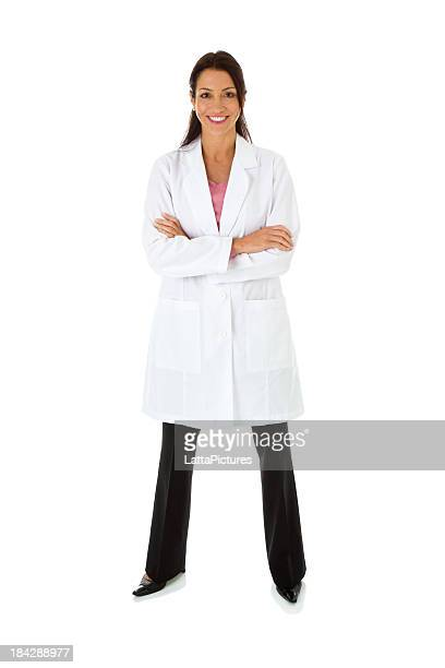 Smiling mid adult female wearing lab coat arms crossed