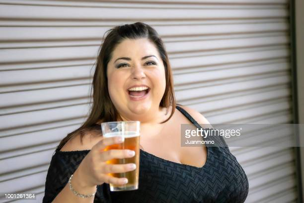 smiling mid adult woman looking at the camera - arab women fat stock pictures, royalty-free photos & images
