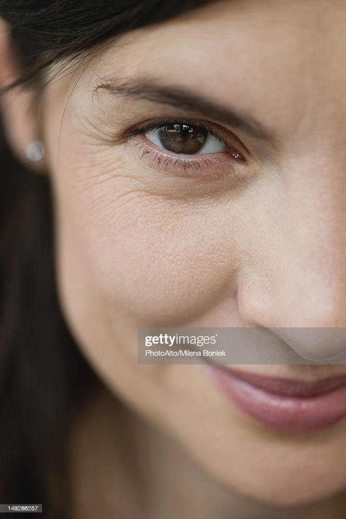 Smiling mid-adult woman, cropped portrait : Stock Photo