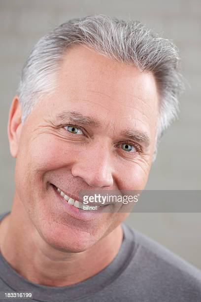 Smiling middle age man with gray hair