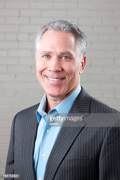 smiling middle age man with gray suit and blue shirt - open collar stock pictures, royalty-free photos & images