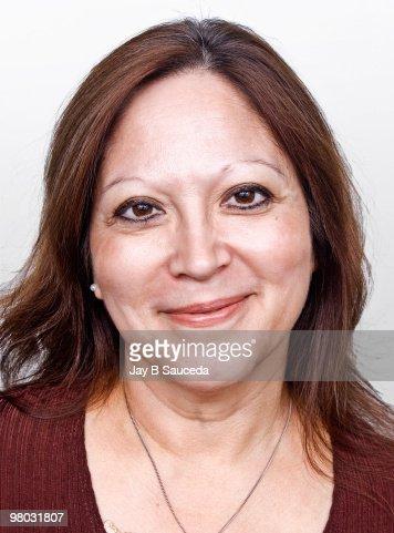Smiling Middle Aged Hispanic Female High Res Stock Photo