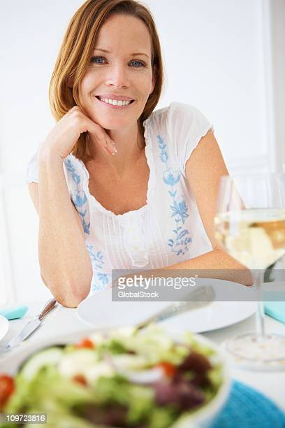 Smiling middle aged woman at the breakfast table