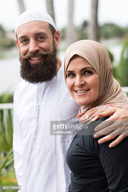 smiling middle eastern couple - imam stock photos and pictures