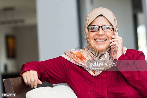 smiling middle eastern woman - images of fat black women stock photos and pictures