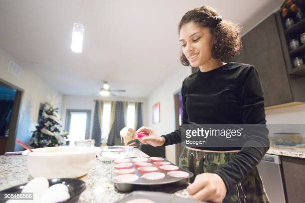 smiling millennial hispanic woman baking at home orlando usa - florida christmas stock pictures, royalty-free photos & images