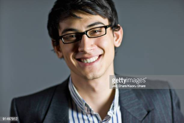 Smiling mixed race businessman in eyeglasses