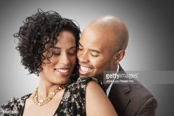 Smiling mixed race couple hugging
