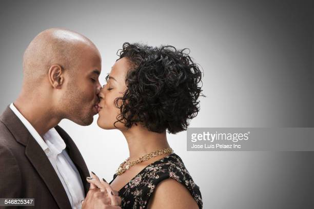 Smiling mixed race couple kissing