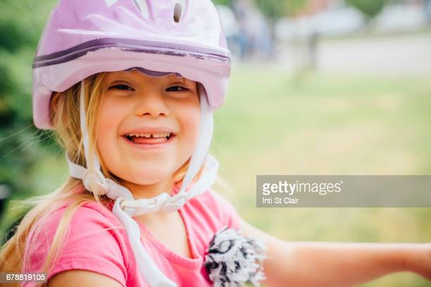 Smiling Mixed Race girl wearing helmet