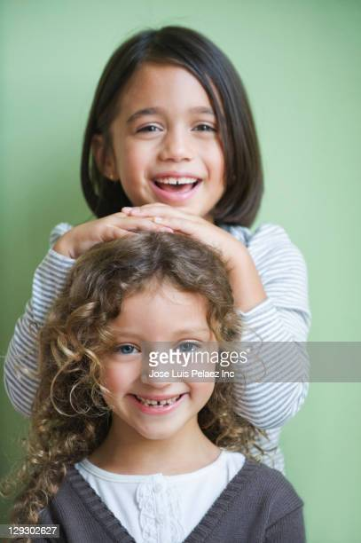 Smiling mixed race girls