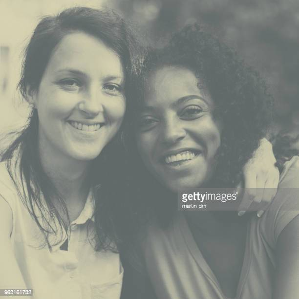smiling mixed race girls together - african american ethnicity photos stock photos and pictures