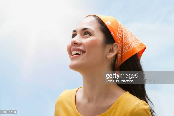 smiling mixed race woman wearing bandana and looking up at sky - bandana stock pictures, royalty-free photos & images