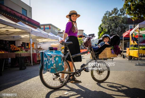 Smiling Mom and Toddler at Farmer's Market With Cargo Bike
