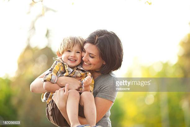 Smiling mother and son outdoors