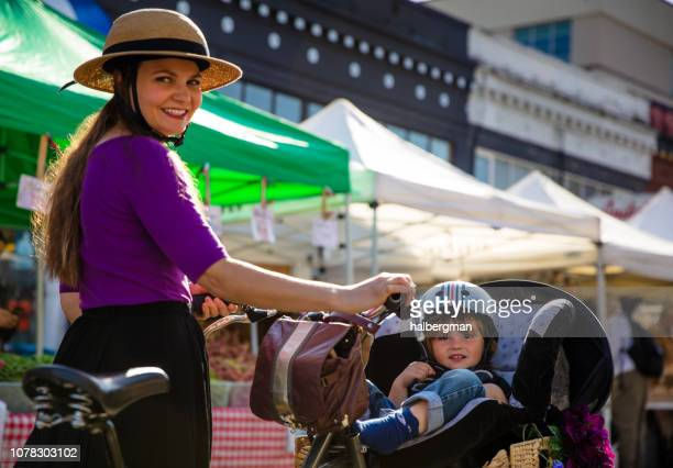 Smiling Mother and Toddler Shopping at Farmer's Market