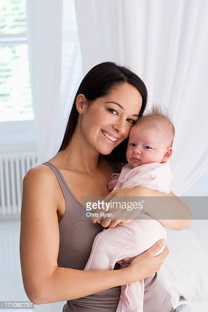 Smiling mother holding baby