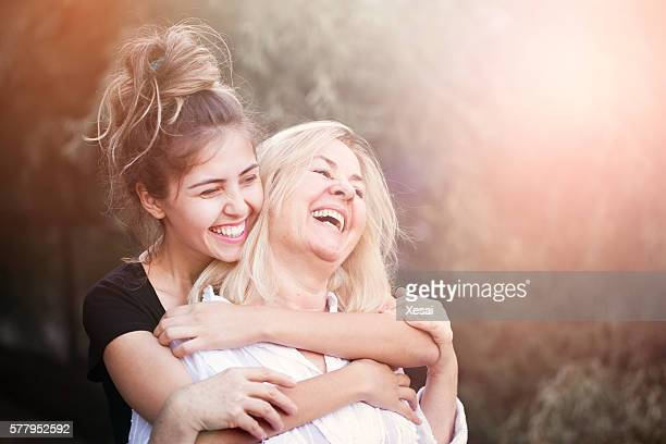 smiling mother with young daughter - mother daughter stock photos and pictures