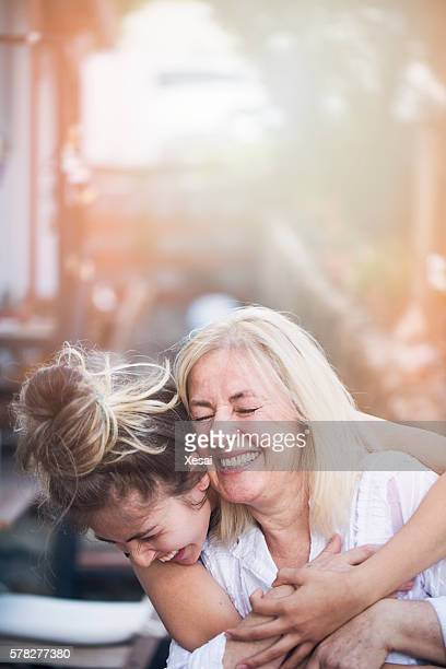 smiling mother with young daughter - vertical stock pictures, royalty-free photos & images