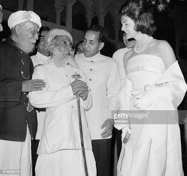 Smiling Mrs Jacqueline Kennedy wife of the American President chats to two veteran retired and bearded Rajput soldiers when she visited the Maharana...