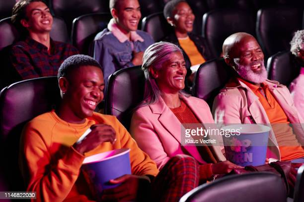 smiling multi-ethnic spectators watching comedy film - comedy film stock pictures, royalty-free photos & images