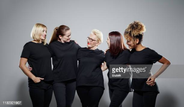 smiling multi-ethnic women wearing black clothes - five people stock pictures, royalty-free photos & images