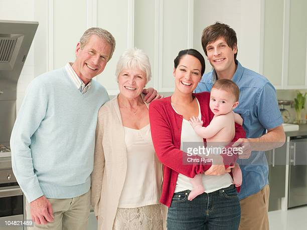 Smiling multi-generation family in kitchen
