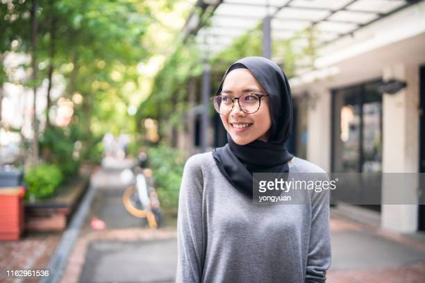 smiling muslim girl - personal accessory stock pictures, royalty-free photos & images