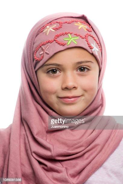 smiling muslim little girl - beautiful turkish girl stock pictures, royalty-free photos & images