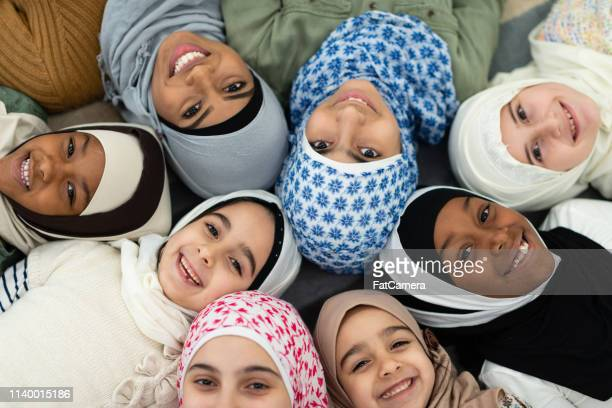 Smiling Muslim overhead portrait