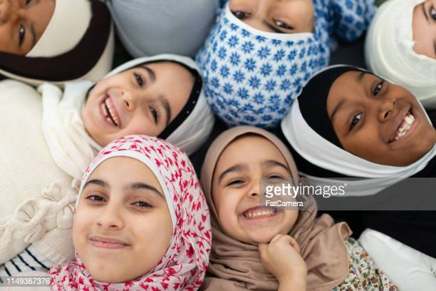 smiling muslim overhead portrait - human rights stock pictures, royalty-free photos & images
